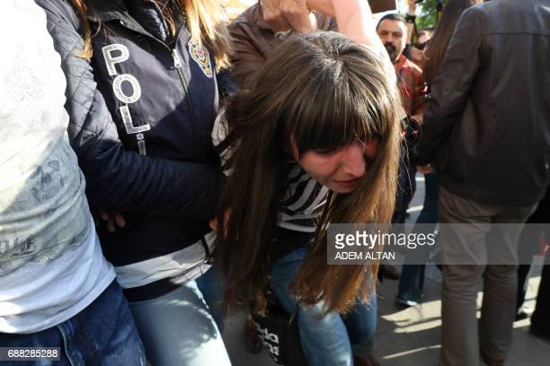 Turkey police arrest a woman during a protest against the arrest of former primary school teacher Semih Ozakca and academic Nuriye Gulmen during...