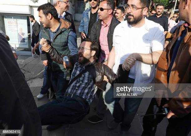 Turkey police detain a man during a protest against the arrest of former primary school teacher Semih Ozakca and academic Nuriye Gulmen during their...