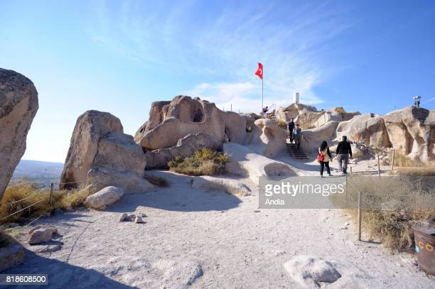 Turkey Uchisar Family visiting the castle of this typical village of Cappadocia region inscribed to the UNESCO World Heritage List