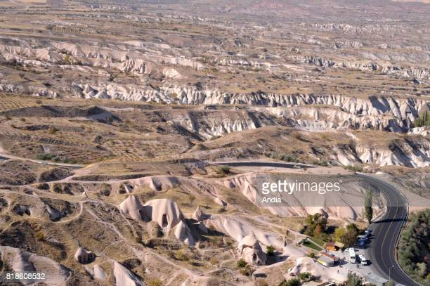 Turkey Uchisar Overview of the village and the surrounding area with the troglodyte dwellings typical from Cappadocia region inscribed to the UNESCO...