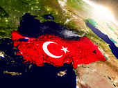 Turkey with embedded flag on planet surface during sunrise. 3D illustration with highly detailed realistic planet surface and visible city lights. 3D model of planet created and rendered in Cheetah3D