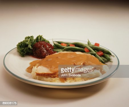 Turkey with mashed potatoes and vegetables