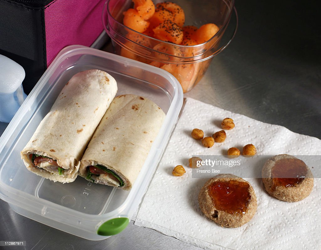 Turkey wraps, whole-wheat cookies, savory chickpeas and melon balls are among the lunch foods that can be prepared by kids for kids.
