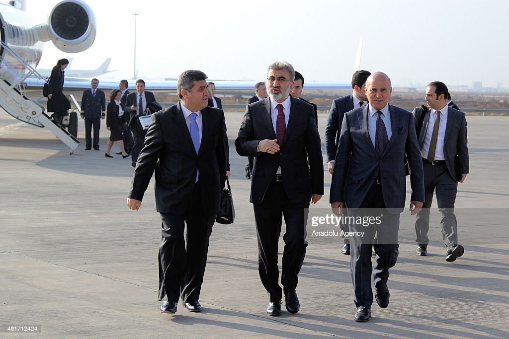 Turkey's ambassador to Iraq Faruk Kaymakci (L) welcomes Turkey's Minister of Energy and Natural Resources, <a gi-track='captionPersonalityLinkClicked' href=/galleries/search?phrase=Taner+Yildiz&family=editorial&specificpeople=5871509 ng-click='$event.stopPropagation()'>Taner Yildiz</a> (L 2) at the Baghdad International Airpot in Baghdad, Iraq on January 18, 2015.