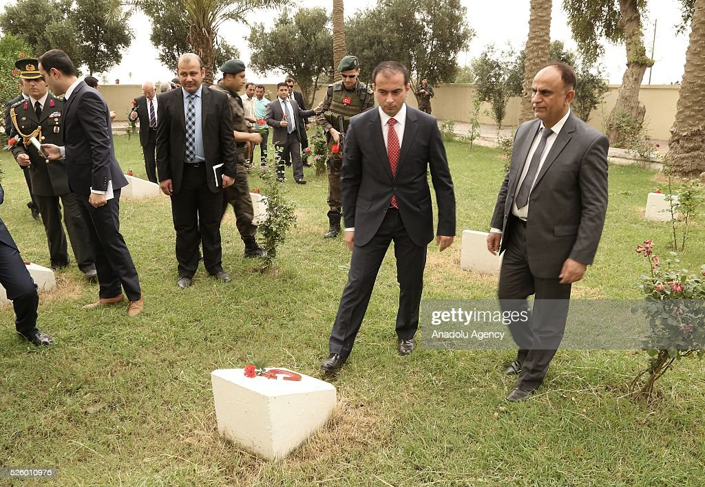 Turkeys Ambassador Undersecretary in Baghdad Sinan Zeren (2nd R) and Kuts Deputy Governor Rashid al-Bediri (R) leave red cloves at the Ottoman Turkish Martyrs cemetery during the ceremony held for 100th anniversary of the Kut al-Amara victory against the British, in Kut, Iraq on April 29, 2016.