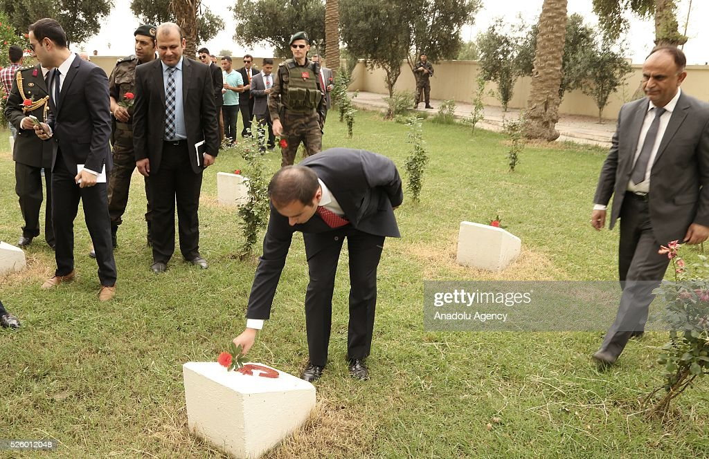 Turkeys Ambassador Undersecretary in Baghdad Sinan Zeren leaves red cloves at the Ottoman Turkish Martyrs cemetery during the ceremony held for 100th anniversary of the Kut al-Amara victory against the British, in Kut, Iraq on April 29, 2016.