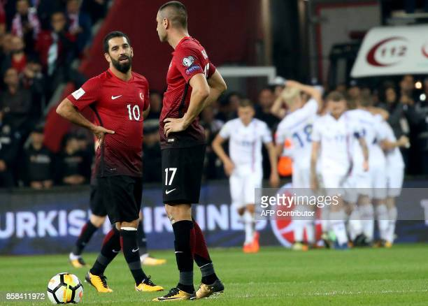 Turkey's Arda Turan and Burak Yilmaz reacts as Iceland's players celebrate scoring their second goal during the FIFA World Cup 2018 qualification...
