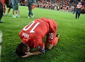 Turkey's Arda Turan celebrates the Turkey's victory over Iceland during the UEFA Euro 2016 qualifying round Group A soccer match at Torku Arena in...