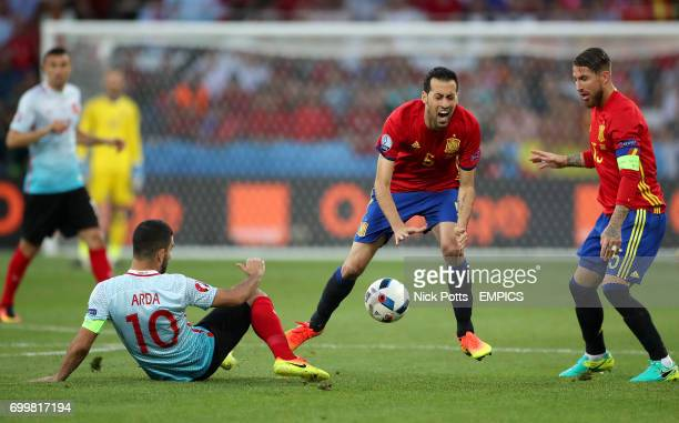 Turkey's Arda Turan challenges Spain's Sergio Busquets for the ball