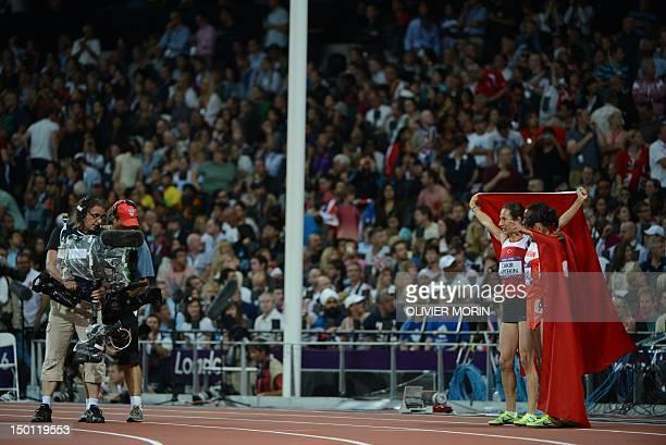 Turkey's Asli Cakir Alptekin Bahrain's Maryam Jamal and Turkey's Gamze Bulut celebrates after the women's 1500m final at the athletics event of the...