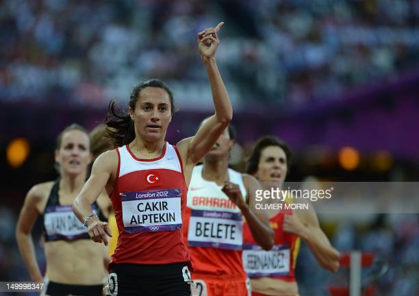 Turkey's Asli Cakir Alptekin celebrates after competing in the women's 1500m semifinals at the athletics event of the London 2012 Olympic Games on...