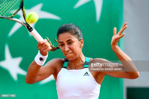 Turkey's Cagla Buyukakcay returns the ball to Croatia's Mirjana LucicBaroni during their tennis match at the Roland Garros 2017 French Open on May 28...