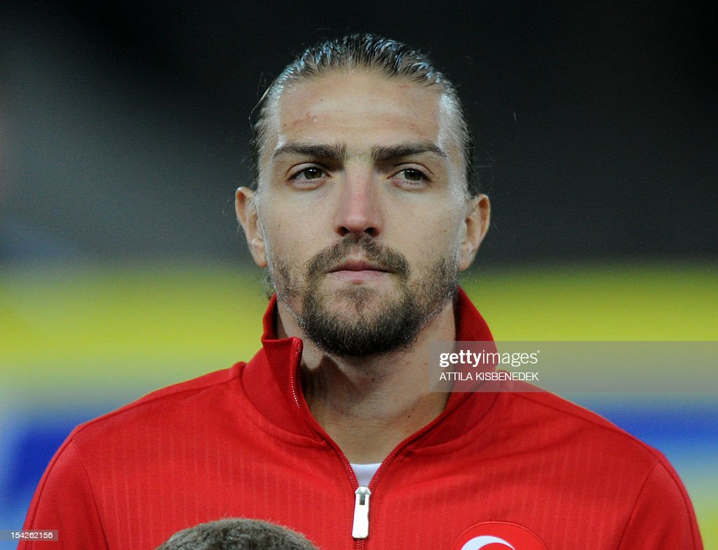 Turkey's <a gi-track='captionPersonalityLinkClicked' href=/galleries/search?phrase=Caner+Erkin&family=editorial&specificpeople=5127933 ng-click='$event.stopPropagation()'>Caner Erkin</a> poses for photographers ahead the FIFA World Cup 2014 qualifying football match against Hungary at the Puskas stadium in Budapest, Hungary on October 16, 2012.