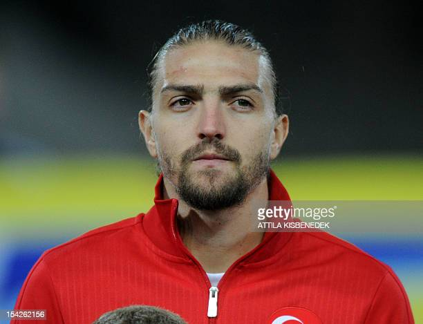 Turkey's Caner Erkin poses for photographers ahead the FIFA World Cup 2014 qualifying football match against Hungary at the Puskas stadium in...