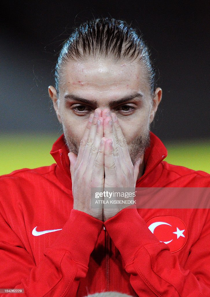 Turkey's <a gi-track='captionPersonalityLinkClicked' href=/galleries/search?phrase=Caner+Erkin&family=editorial&specificpeople=5127933 ng-click='$event.stopPropagation()'>Caner Erkin</a> reacts ahead the FIFA World Cup 2014 qualifying football match against Hungary at the Puskas stadium in Budapest, Hungary on October 16, 2012.