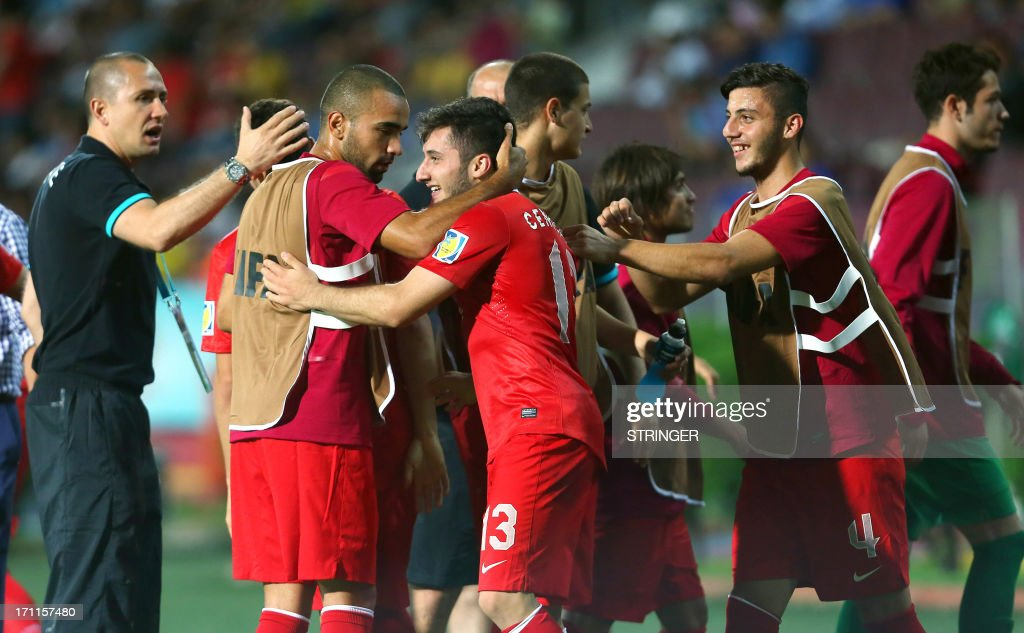 Turkey's Cenk Sahin (C) celebrate his goal with teammates during the group stage football match between Turkey and El Salvador at the FIFA Under 20 World Cup at the Avni Aker stadium in Trabzon on June 22, 2013.