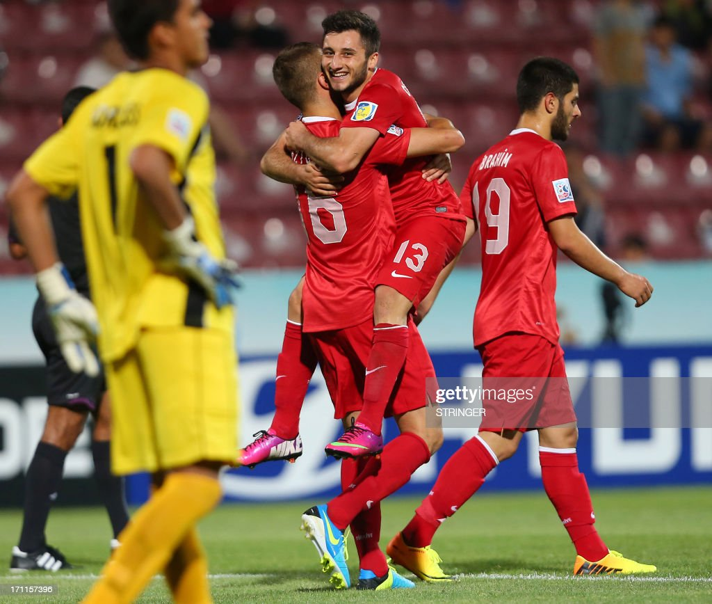 Turkey's Cenk Sahin (C) celebrate with teammates after scoring a goal during the group stage football match between Turkey and El Salvador at the FIFA Under 20 World Cup at the Avni Aker stadium in Trabzon on June 22, 2013. AFP PHOTO / TURKPIX