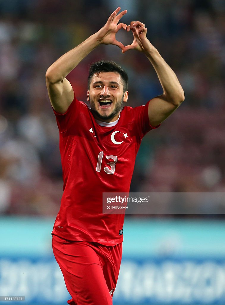 Turkey's Cenk Sahin gestures as he celebrates scoring during the group stage football match between Turkey and El Salvador at the FIFA Under 20 World Cup at the Avni Aker stadium in Trabzon on June 22, 2013.