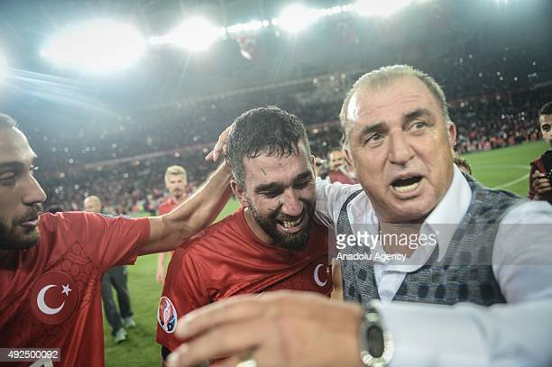 Turkey's Cenk Tosun Arda Turan and Fatih Terim Turkish association football manager are seen as they celebrate their victory over Iceland during the...