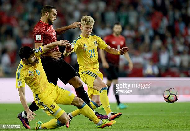 Turkey's Cenk Tosun vies for the ball with Ukraine's Taras Stepanenko and Oleksandr Zinchenko during the World Cup 2018 football qualification match...