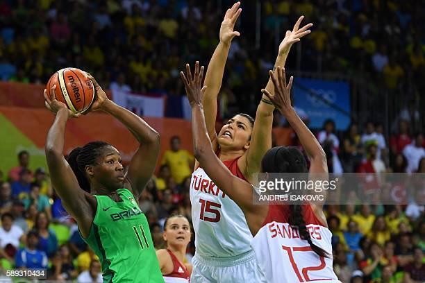 TOPSHOT Turkey's centre Lara Sanders and Turkey's power forward Tilbe Senyurek defend against Brazil's power forward Clarissa Santos during a Women's...