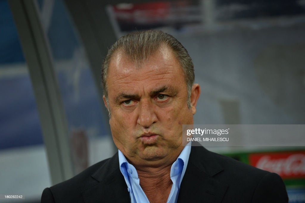 Turkey's Coach Fatih Terim reacts during the FIFA World Cup 2014 qualifying football match Romania vs Turkey in Bucharest on September 10, 2013. AFP PHOTO / DANIEL MIHAILESCU