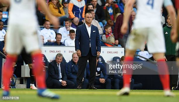 Turkey's coach Fatih Terim watches from the touchline during the friendly football match between England and Turkey at the Etihad Stadium in...