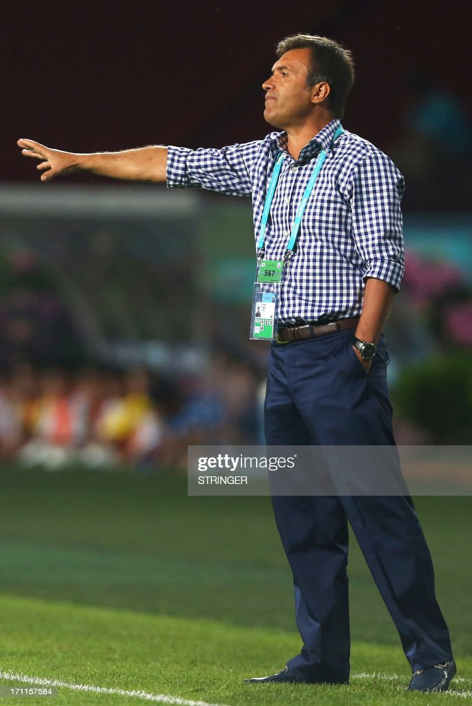 Turkey's Coach Feyyaz Ucar gestures during the group stage football match between Turkey and El Salvador at the FIFA Under 20 World Cup at the Avni Aker stadium in Trabzon on June 22, 2013.