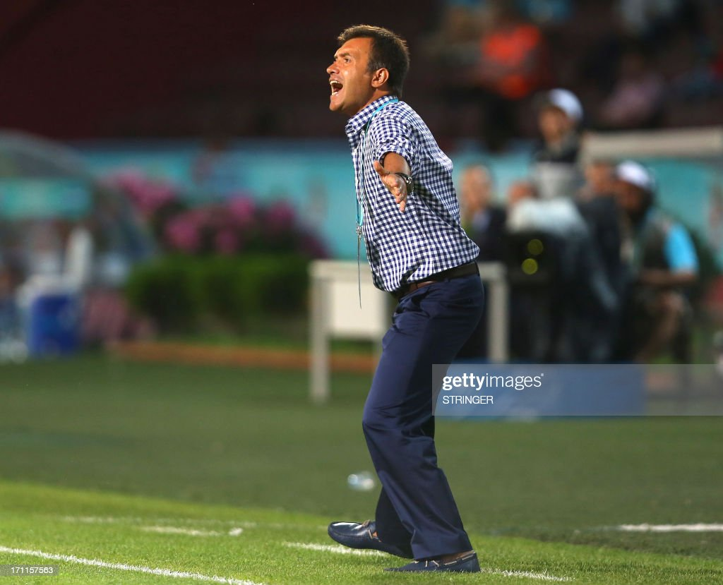 Turkey's Coach Feyyaz Ucar reacts during the group stage football match between Turkey and El Salvador at the FIFA Under 20 World Cup at the Avni Aker stadium in Trabzon on June 22, 2013.