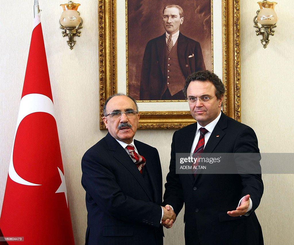 Turkey's Deputy Prime Minister Besir Atalay(L) shakes hands on February 6, 2013 with German Interior Minister Hans-Peter Friedrich prior to their meeting at the Prime Minister's office in Ankara.