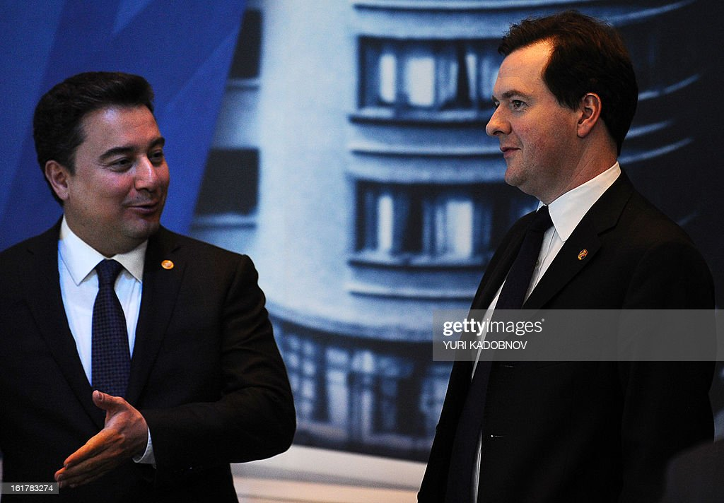 Turkey's Deputy Prime Minister for Economic and Financial Affairs, Ali Babacan (L) speaks with British Chancellor of the Exchequer George Osborne (R) after G20 states finance ministers and central bank governors meeting in Moscow, on February 16, 2013. The ministers and central bank governors gathered today in Moscow for their first meeting in the Russian capital aimed at reassuring markets that the world's economic powers would not slug it out in 'currency wars' to boost national growth. AFP HOTO / YURI KADOBNOV