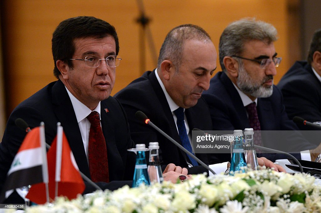Turkey's Economy Minister Nihat Zeybekci (L), Foreign Minister Mevlut Cavusoglu (C) and Energy Minister <a gi-track='captionPersonalityLinkClicked' href=/galleries/search?phrase=Taner+Yildiz&family=editorial&specificpeople=5871509 ng-click='$event.stopPropagation()'>Taner Yildiz</a> (R) attend the Turkey-Iraq Business Council Meeting in Ankara, Turkey on December 25, 2014.