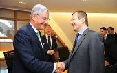 Turkey's EU Minister and Chief Negotiator Volkan Bozkir shake hands with European Parliament's Group of the European People's Party's foreign affairs...