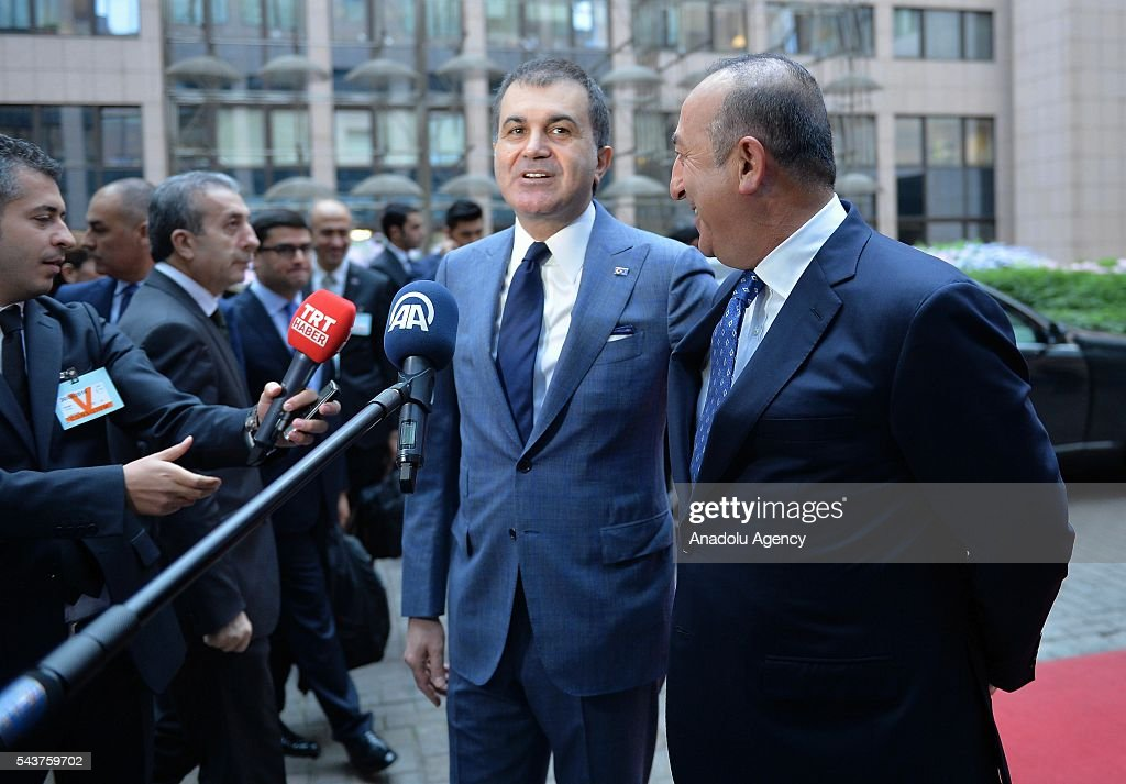 Turkey's EU Minister Omer Celik (L) and Turkish Foreign Minister Mevlut Cavusoglu speak to media ahead of the Chapter 33 on financial and budgetary provisions as part of the EU-Turkey Intergovernmental Accession Conference in Brussels, Belgium on June 30, 2016.