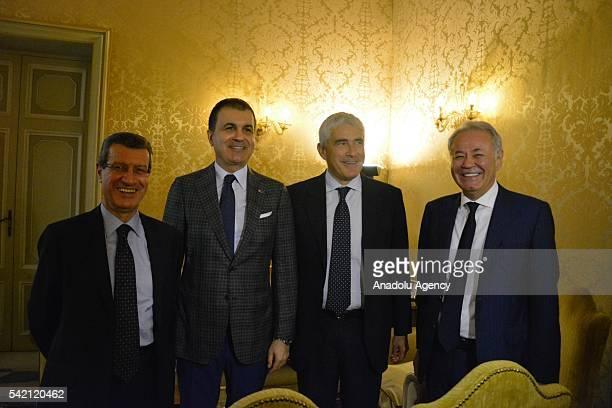 Turkey's EU Minister Omer Celik poses with President of the InterParliamentary Union Pier Ferdinando Casini and President of the European Union...