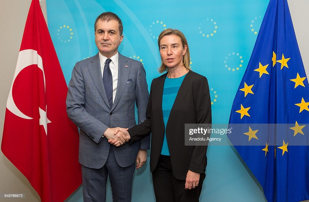 Turkey's EU Minister Omer Celik (L) shakes hands with High Representative of the European Union for Foreign Affairs and Security Policy Federica Mogherini (R) in Brussels, Belgium on June 30, 2016.