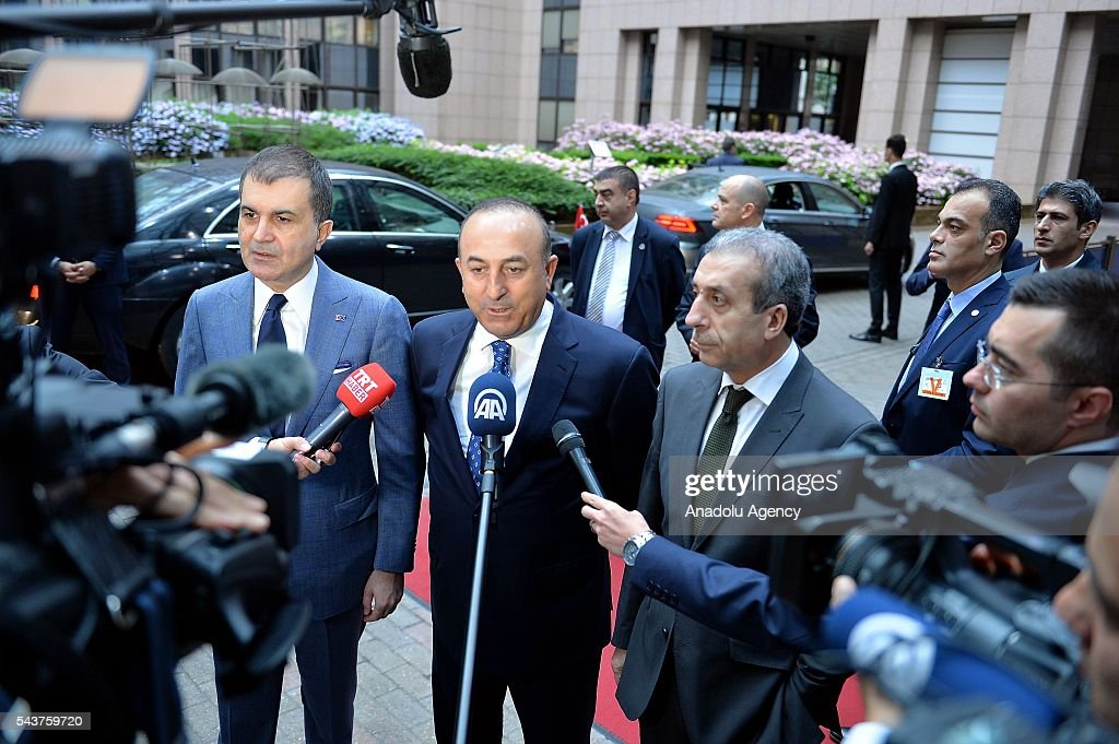 Turkey's EU Minister Omer Celik (L), Turkish Foreign Minister Mevlut Cavusoglu and Vice chairman of Justice and Development Party, Mehdi Eker (R2) speak to media ahead of the Chapter 33 on financial and budgetary provisions as part of the EU-Turkey Intergovernmental Accession Conference in Brussels, Belgium on June 30, 2016.
