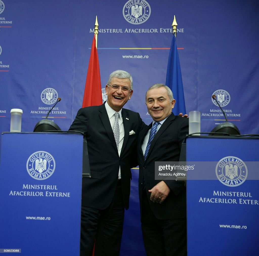 Turkey's EU Minister Volkan Bozkir (R) and Romanian Foreign Minister Lazar Comanescu (L) pose during a joint press conference after their meeting in Bucharest, Romania on February 11, 2016.
