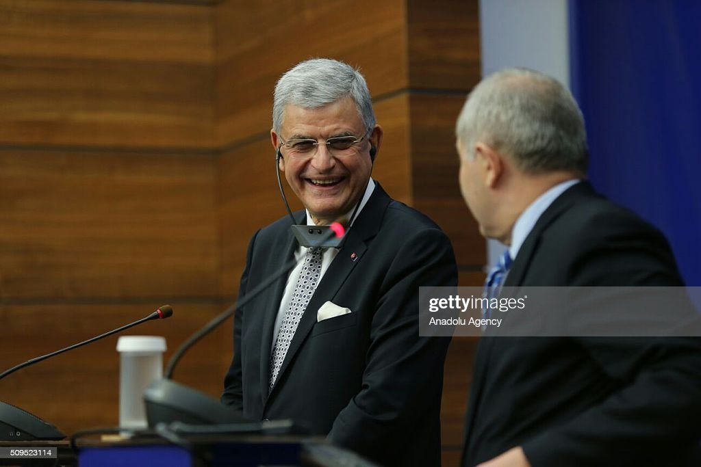Turkey's EU Minister Volkan Bozkir (R) and Romanian Foreign Minister Lazar Comanescu (L) look at each other during a joint press conference after their meeting in Bucharest, Romania on February 11, 2016.