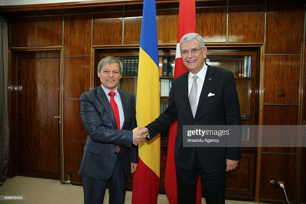 Turkey's EU Minister Volkan Bozkir (2nd R) and Romanian Prime Minister Dacian Ciolos (2nd L) shake hands before they hold a joint inter-delegations meeting in Bucharest, Romania on February 11, 2016.