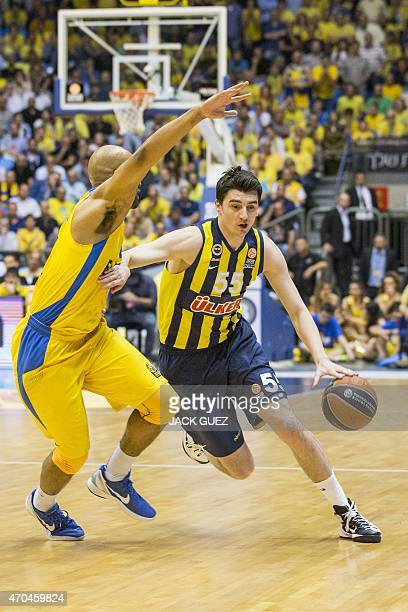 Turkey's Fenerbahce Ulker Istanbul's Turkish forward Emir Preldzic Emir vies for the ball against Israel Maccabi Electra Tel Aviv's US guard Devin...