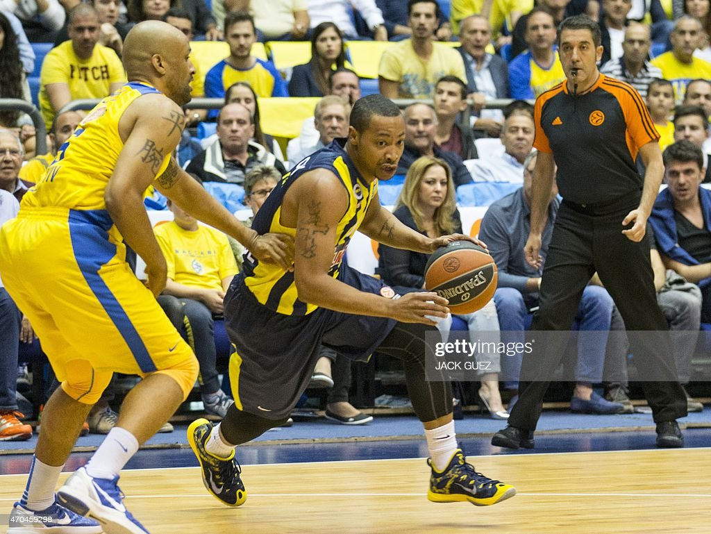 Turkey's Fenerbahce Ulker Istanbul's US guard <a gi-track='captionPersonalityLinkClicked' href=/galleries/search?phrase=Andrew+Goudelock&family=editorial&specificpeople=7364062 ng-click='$event.stopPropagation()'>Andrew Goudelock</a> (R) vies for the ball against Israel's Maccabi Electra Tel Aviv's US guard <a gi-track='captionPersonalityLinkClicked' href=/galleries/search?phrase=Devin+Smith+-+Basketball+Player&family=editorial&specificpeople=13926073 ng-click='$event.stopPropagation()'>Devin Smith</a> (L) during their Euroleague Playoff basketball match, round 3, between Fenerbahce Ulker Istanbul and Maccabi Electra Tel Aviv, on April 20, 2015 at the Menora Mivtachim Arena stadium in the Israeli Mediterranean coastal city of Tel Aviv.