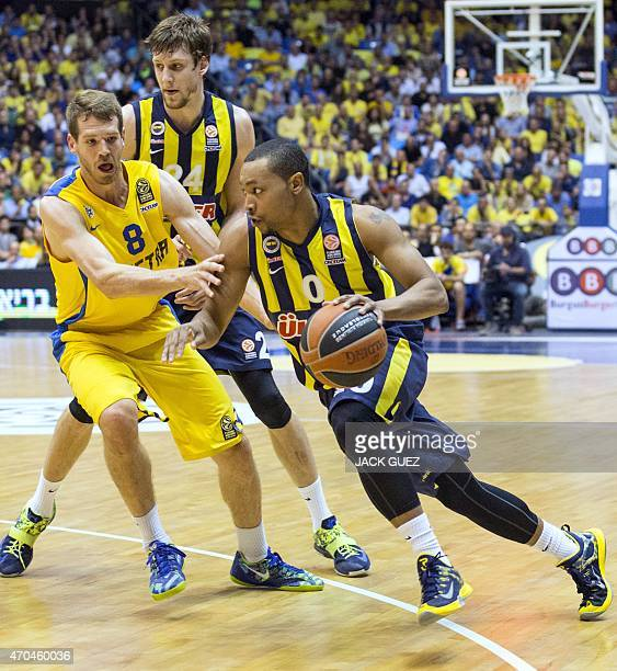 Turkey's Fenerbahce Ulker Istanbul's US guard Andrew Goudelock vies for the ball against Israel Maccabi Electra Tel Aviv's US forward Nate Linhart...