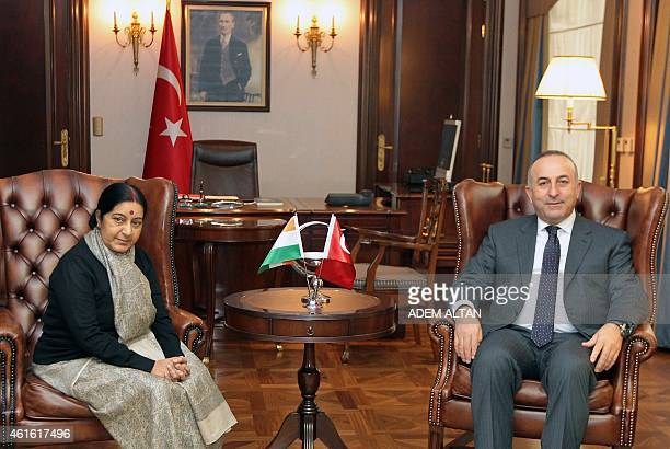 Turkey's Foreign Affairs minister Mevlut Cavusoglu poses with his Indian counterpart Sushma Swaraj prior to a meeting in Ankara on January 16 2015...