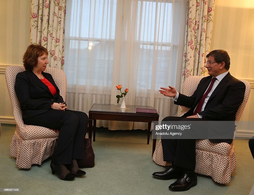 Turkey's Foreign Minister Ahmet Davutoglu (R) meets European Union High Representative for Foreign Affairs and Security Policy Catherine Ashton (L) at the 50th Munich Security Conference to be held between 31st January and 2nd February at the Bayerischer Hof hotel on February 1, 2014 in Munich, Germany.