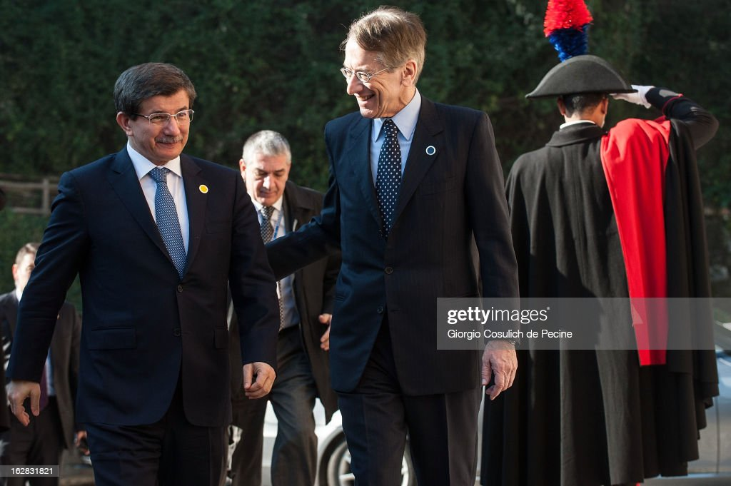 Turkey's Foreign Minister Ahmet Davutoglu (L) meets with Italy's Foreign Minister Giulio Terzi as he arrives to attend a meeting of the 'Friends of the Syrian People' attended by US Secretary John Kerry, at Villa Madama on February 28, 2013 in Rome, Italy. Kerry stated that the opposition needs 'more help' in the fight against President Bashar Hafez al-Assad. The new U.S. Secretary of State is on his first trip and is visiting nine nations in Europe and the Middle East.