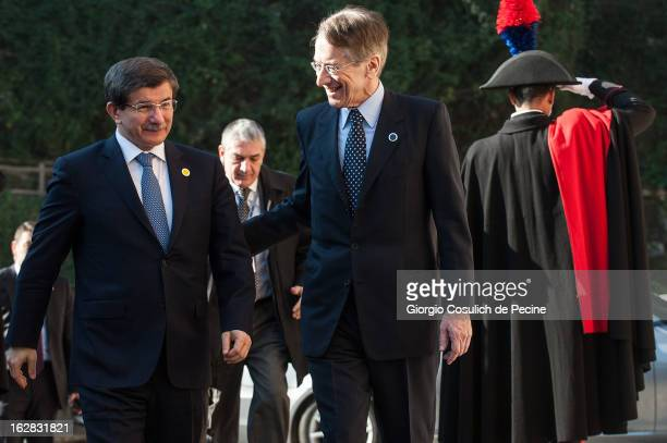 Turkey's Foreign Minister Ahmet Davutoglu meets with Italy's Foreign Minister Giulio Terzi as he arrives to attend a meeting of the 'Friends of the...