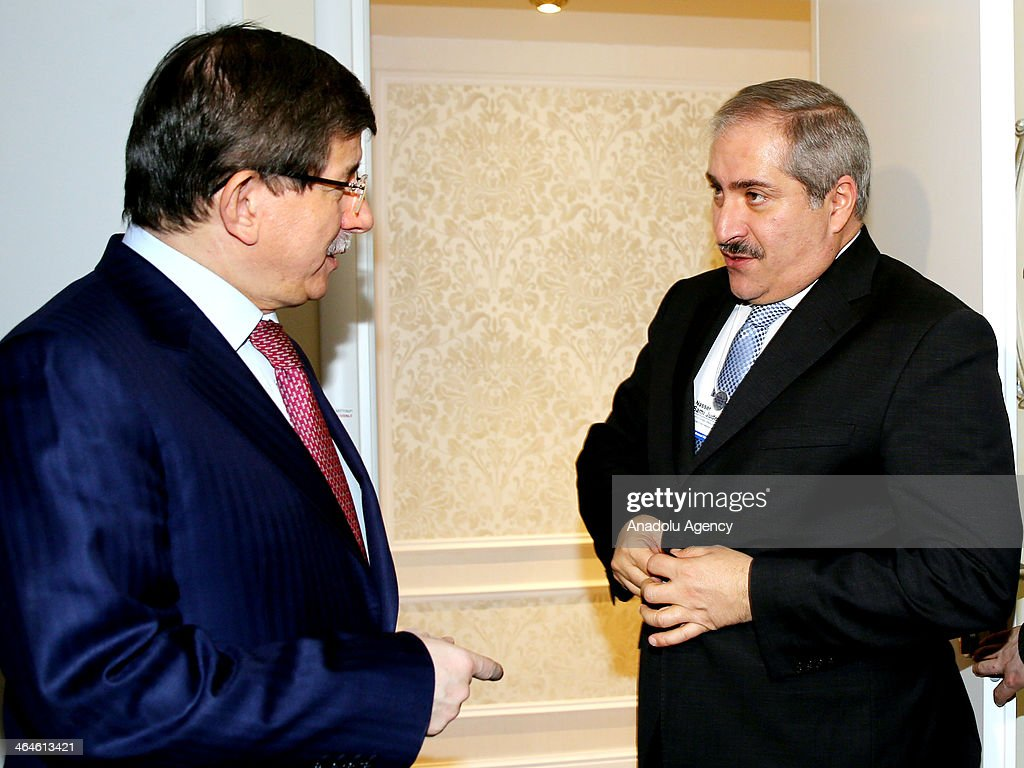 Turkey's Foreign Minister Ahmet Davutoglu (L) meets with Jordanian Foreign Minister and President of the United Nations Security Council Nasser Judeh (R) during the World Economic Forum in Davos, Switzerland, on January 23, 2014.
