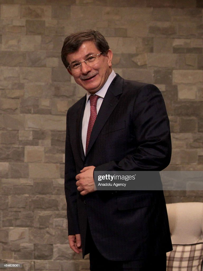 Turkey's Foreign Minister Ahmet Davutoglu meets with President of the Iraqi Kurdistan Masoud Barzani (not seen) during the World Economic Forum in Davos, Switzerland, on January 23, 2014.