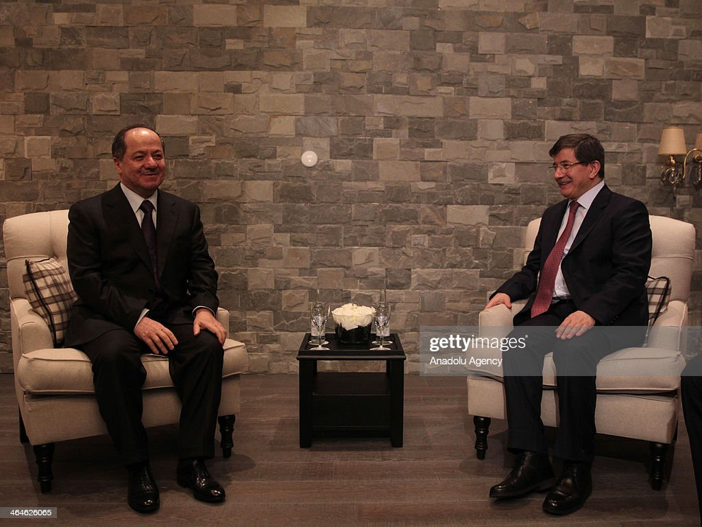 Turkey's Foreign Minister Ahmet Davutoglu (R) meets with President of the Iraqi Kurdistan Masoud Barzani (L) during the World Economic Forum in Davos, Switzerland, on January 23, 2014.